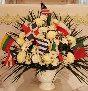 Vase with fflowers and flags